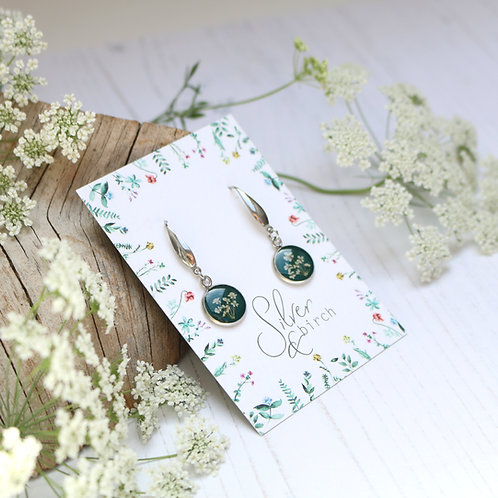 Surgical stainless steel dangly earrings in Forest green, with real flowers