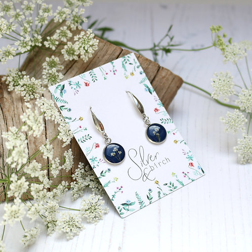 Surgical stainless steel dangly earrings in Navy blue, with real flowers
