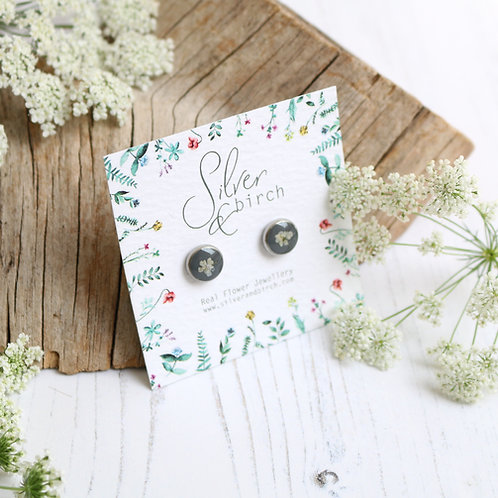 Surgical stainless steel stud earrings in charcoal grey, with real flower