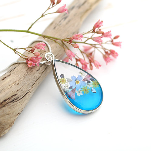 Translucent blue real flowers silver teardrop necklace