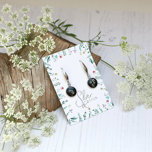 Surgical stainless steel dangly earrings in Jet black, with real flowers