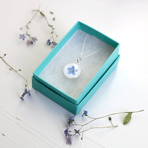 Sterling silver circle necklace with real blue forget me not flower