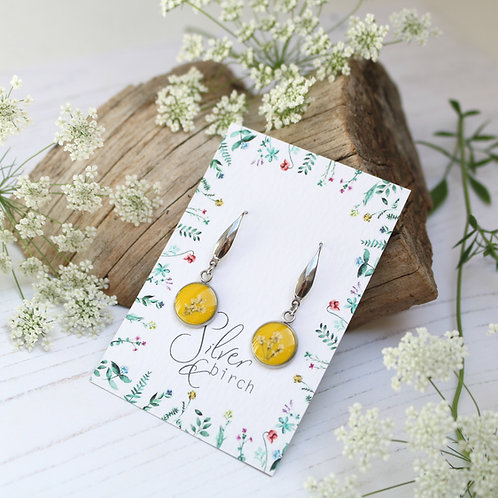 Surgical stainless steel dangly earrings in Mustard yellow, with real flowers