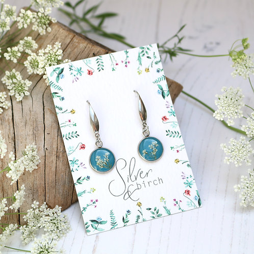 Surgical stainless steel dangly earrings in Teal, with real flowers