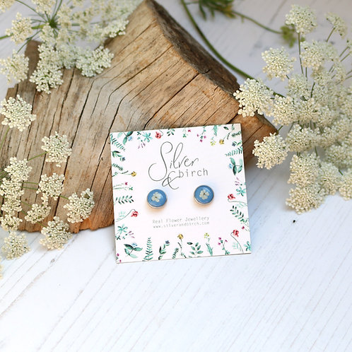 Surgical stainless steel stud earrings in Sky blue, with real flower