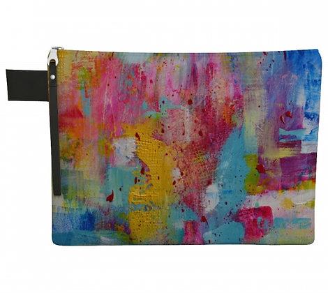 Pochette en tissu rose, turquoise, jaune, bleu, produit dérivé de l'oeuvre abstraite de l'artiste peintre Gisèle Vivier