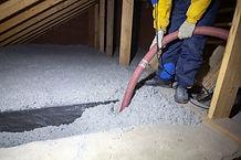 Spraying cellulose insulation in the att