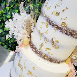 Two Tiered semi naked with edible gold leaf and dried flowers