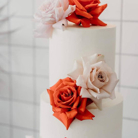 Two Tiered Large Choc Raspberry + Banana & Caramel with Full coverage icing and florist flowers