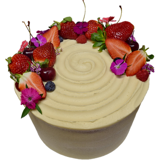 vanilla icing with berries and flowers l