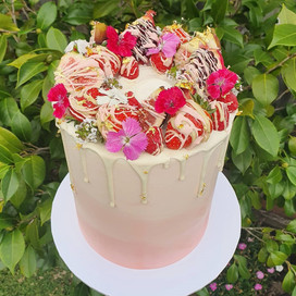 Medium Slim Raspberry White Choc with pink & white ombre, white choc drip and edible gold leaf.