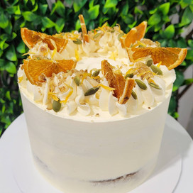 Classic Carrot cake with a semi naked finish with dried orange, walnuts and pepita seeds