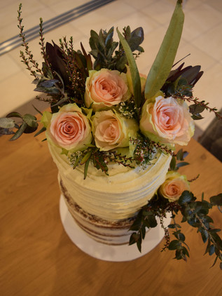 2 tiered vanilla iced with floral.jpg