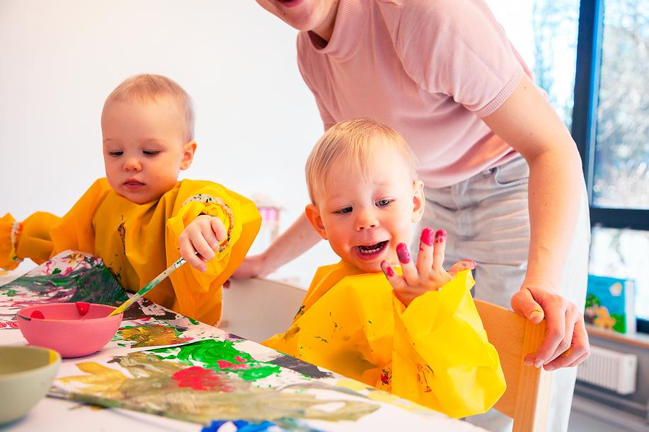 Kids having fun painting.png