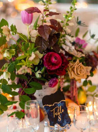samara_floral_wedding_flowers_centerpiece_arrangement_moody_art_ranunculus_colorful_reception