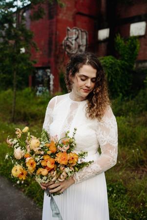 samara_floral_bride_bridal_gown_bouquet_orange_ranunculus_organic_wild_ethereal_style_beautiful_best_florist