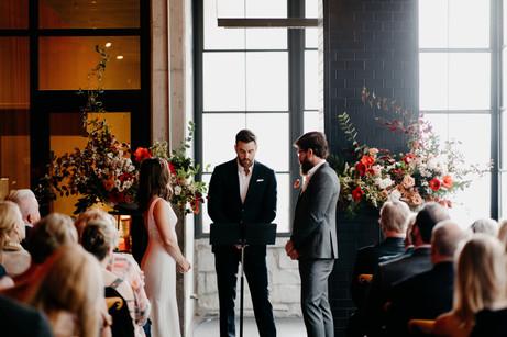 samara_floral_atlanta_wedding_florist_moody_ceremony_rings_bride_groom_arrangement_flowers_roses_love_industrial