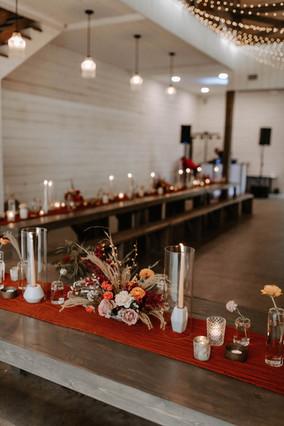 wedding_reception_florist_organic_florals_wedding_flowers_love_red_bohemian_tapers_candles_candlelight_organic_modern_centerpiece_arrangement