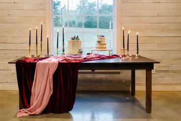 samara_floral_wedding_flowers_atlanta_georgia_purple_pink_moody_cake_table_tapers_black