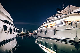 Luxury Yachts In La Spezia Harbor At Night With Reflection In Water. Italy.jpg