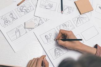 hands-draw-storyboard-film_8119-2582.jpg