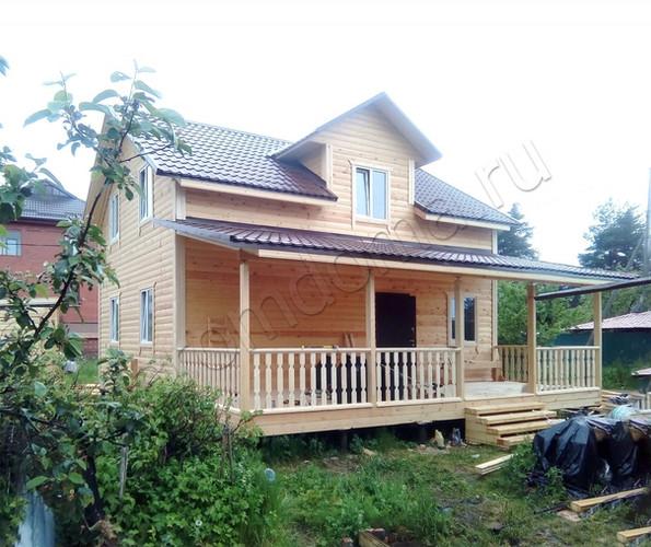 dom-iz-brusa-6x9-v-poltora-etazha-foto-1