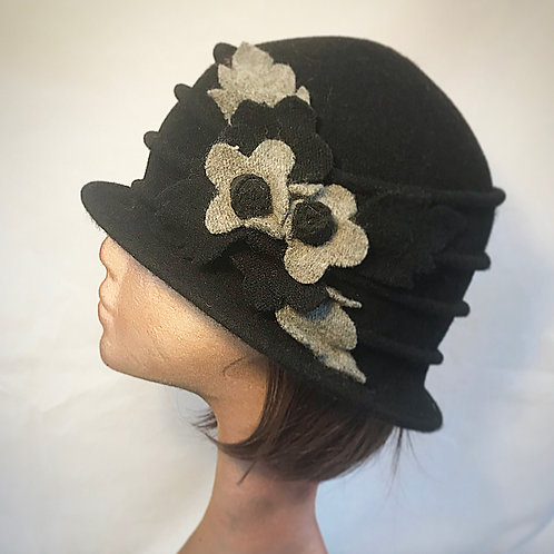 Black soft hat grey flower embellishment