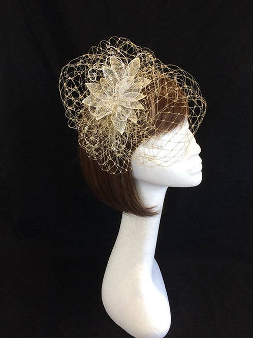 Gold veiled fascinator