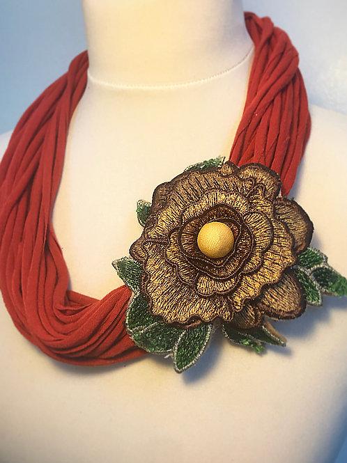 Orange brooch loop scarf