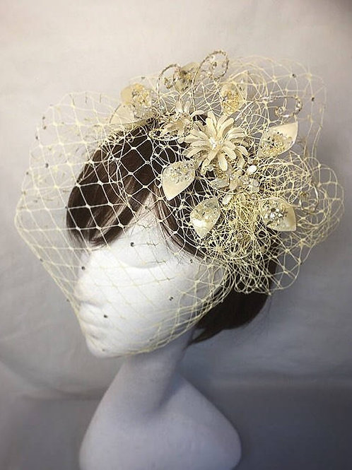 Cream veiled fascinator