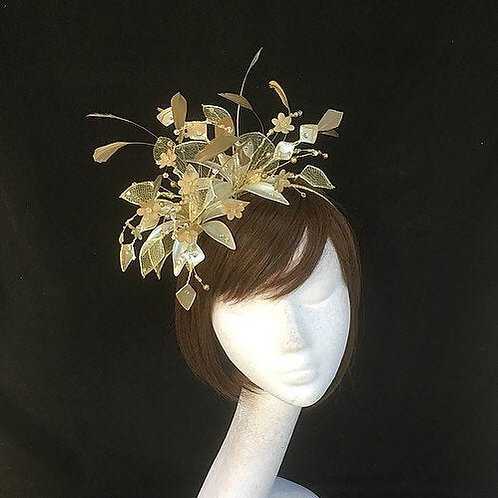 Gold feather fascinator