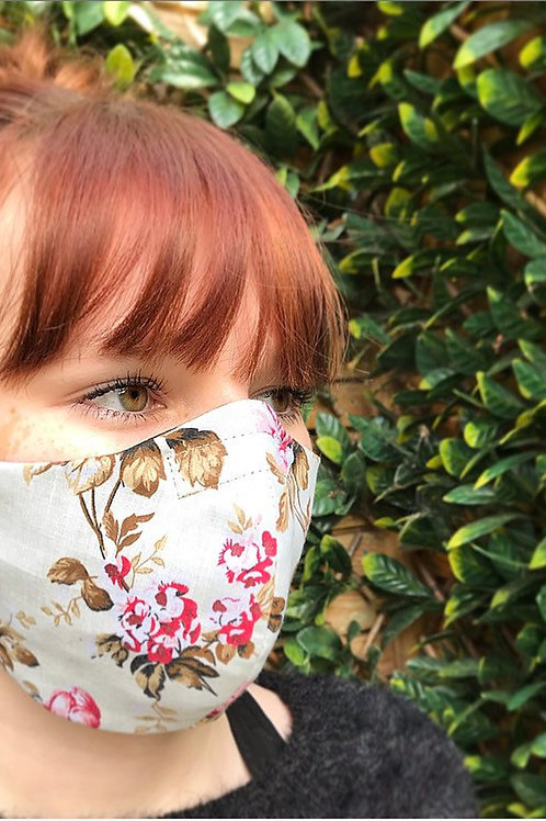 Cream floral face mask