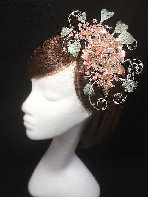 Pink and green fascinator