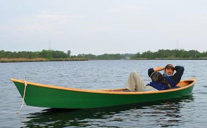 Man relaxing in his homemade Cajun Secret pirogue