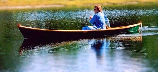 A classic pirogue glides gracefully across the water