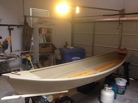 Beautiful homemade pirogue in a garage
