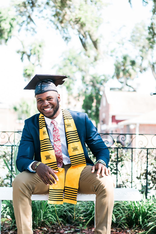 College graduate sitting. Photo by William Stitt on Unsplash