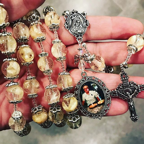 A beautiful petal bead rosary gifted to the widow of this Beloved man by his daughters.jpg