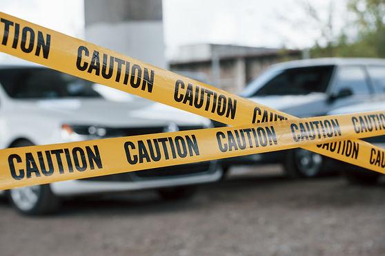 black-white-vehicles-yellow-caution-tape