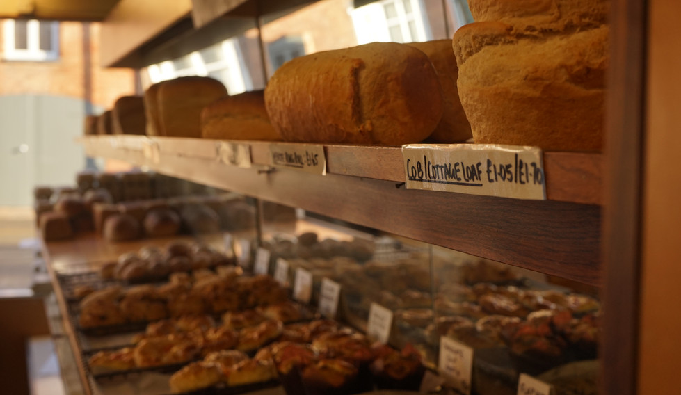 Our shop scattefed with different breads and confectionaries