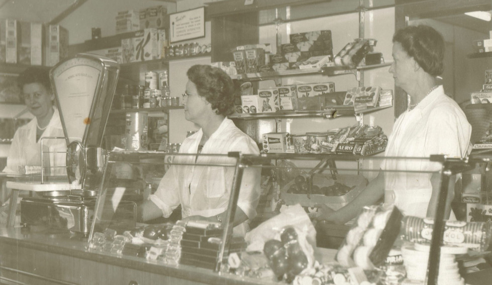 Mrs West (left) behind the shop counter