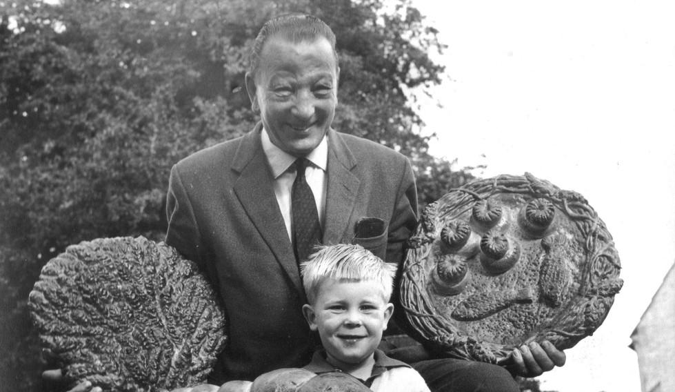 Reg West with grandson, Clive Lane during harvest time