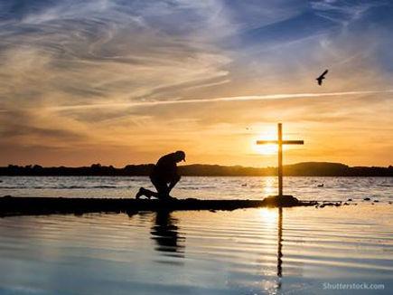 man-kneeling-prayer-cross-water.jpg