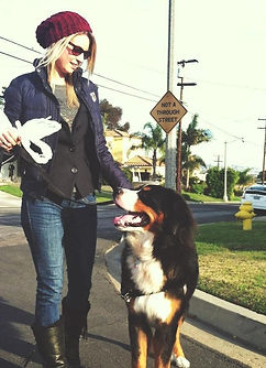 Happy Paws owner Stephanie walking a dog, Baxter
