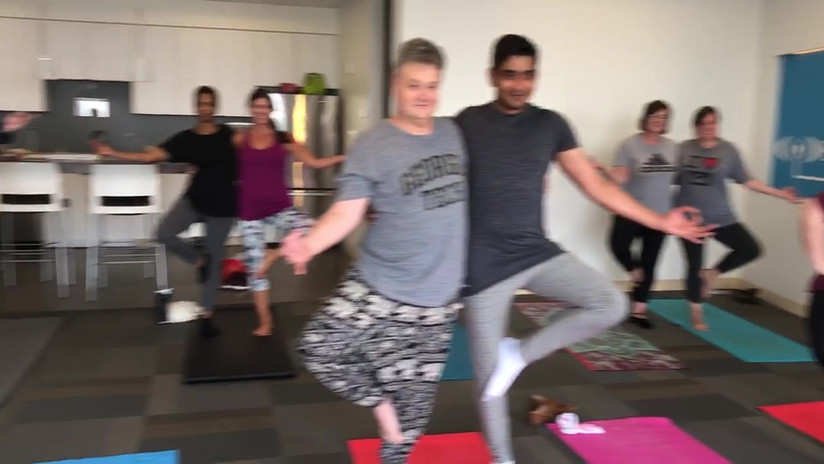 Parterner Tree Pose during Office Yoga