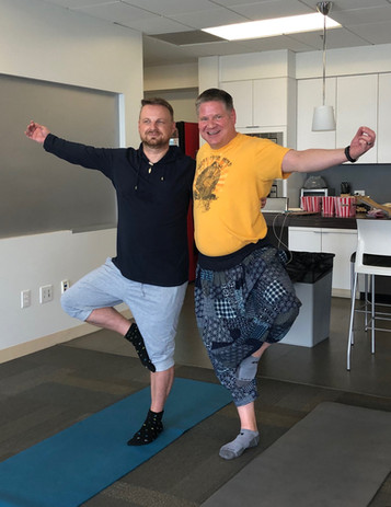Arms open for yoga in the office