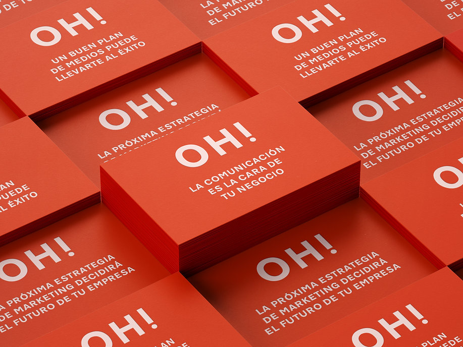 Red business cards, part of the branding designed for the stationery of an advertising agency in Barcelona