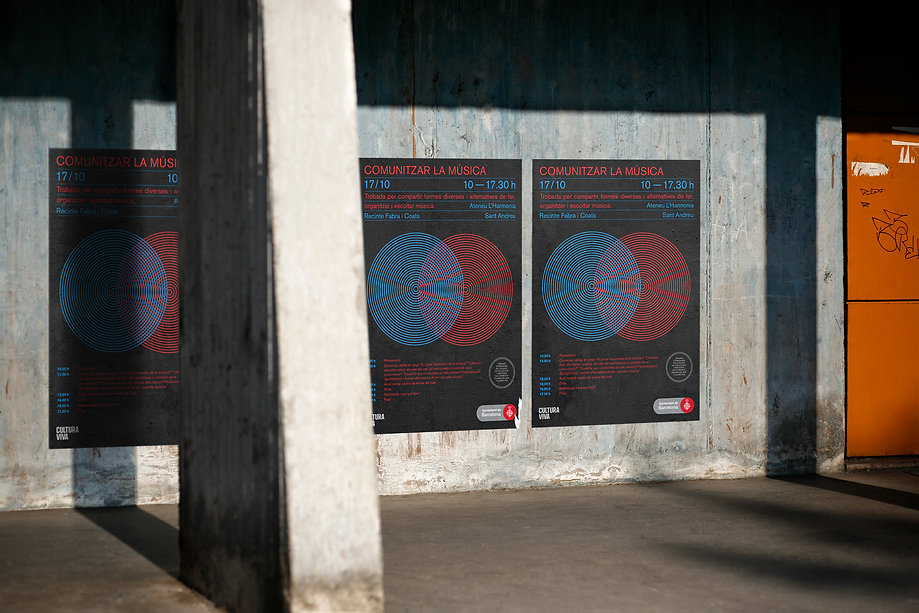 Minimalist and op-art graphic design posters for a music festival hanged up inside an industrial building of Barcelona