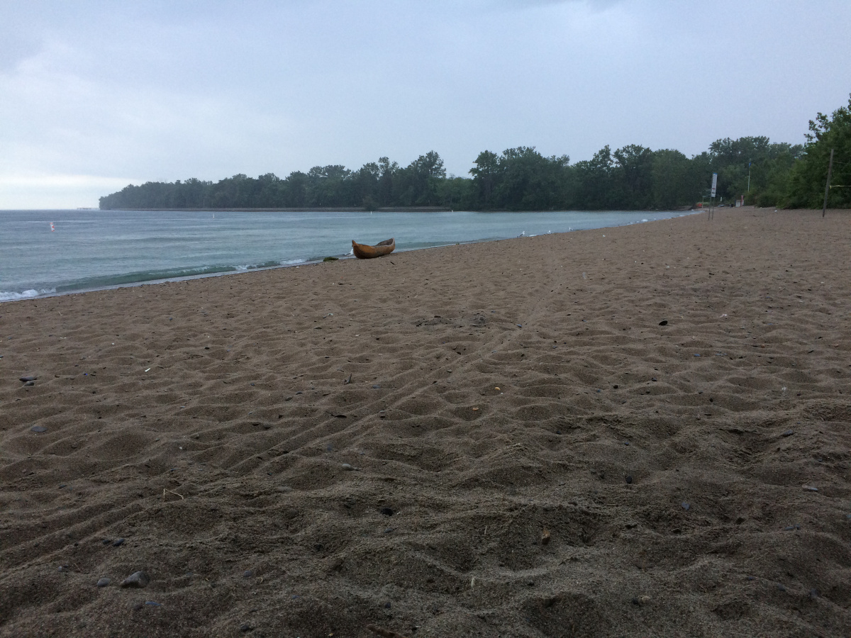 A carved Boat on a beach, last year it was still a log.
