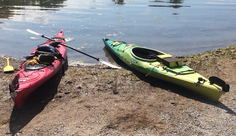 two kayaks on the dirt shore of lake Simcoe